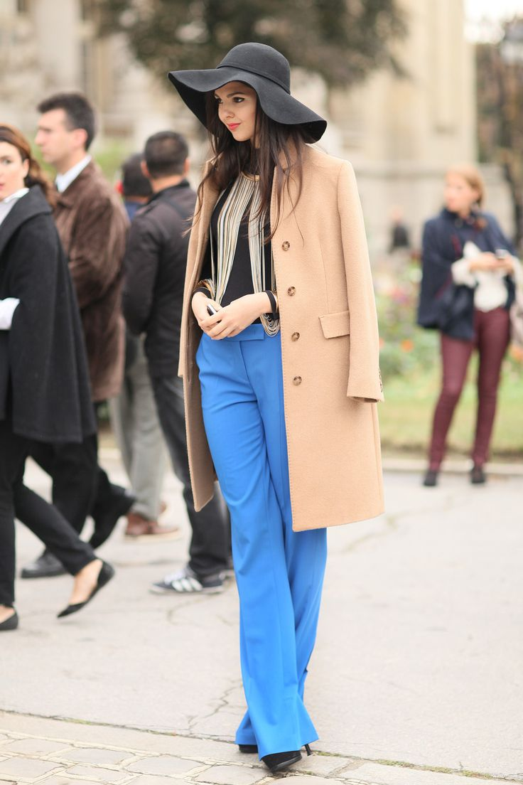 A camel coat grounded these bright pants and statement necklace with a classical touch.
