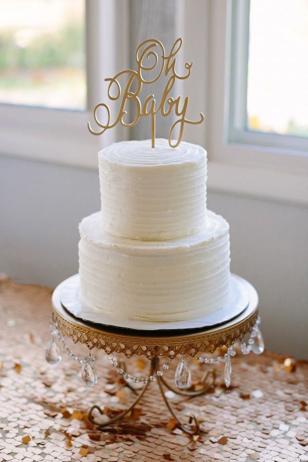 Two tier white baby shower cake on vintage plating: http://www.stylemepretty.com/living/2016/10/08/we-love-this-beautiful-alternative-to-a-traditional-baby-shower/ Photography: Katherine Salvatori - http://katherinesalvatori.com/
