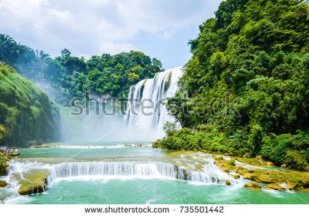 China Guizhou Huangguoshu Waterfall in Summer. It is one of the largest waterfalls in China and East Asia, classified as a AAAAA scenic area by the China National Tourism Administration.