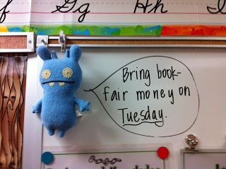 have a class mascot to do reminders - too cute! Or phrase of the day...