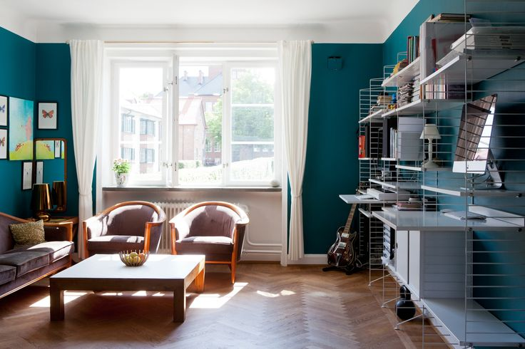 Scandinavian apartment design. Amazing wall color. Dark turquoise wall paint.