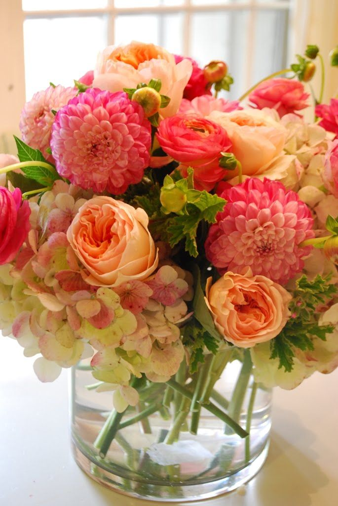 "Hydrangea, ranuculus, dahlias, david austen ""juliet"" roses and scented geranium leaves"