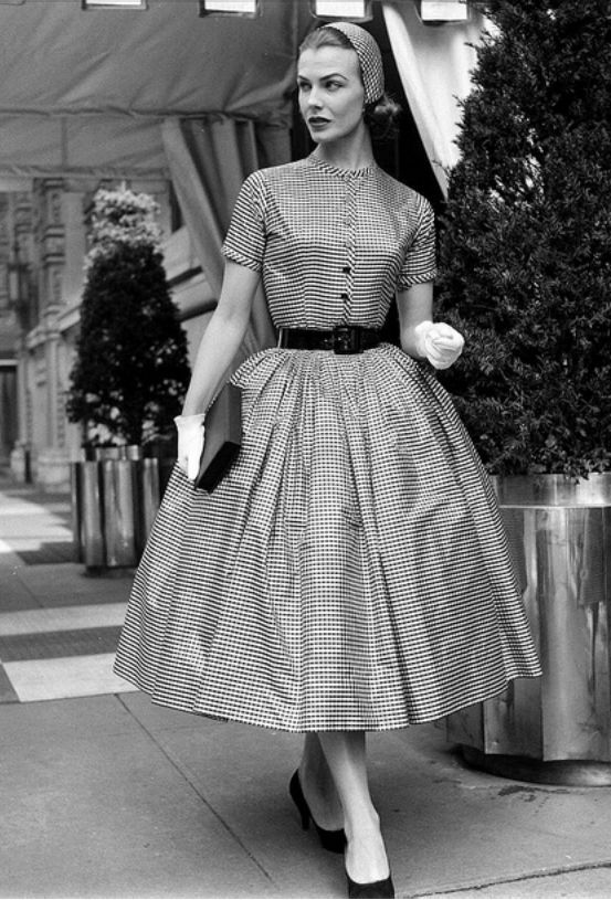 1955 Lillian Marcuson with the outside layers of hat and dress removed, the wide-skirted checked taffeta by Traina-Norell and matching cap by Emme can be worn to parties, photo by Nina Leen