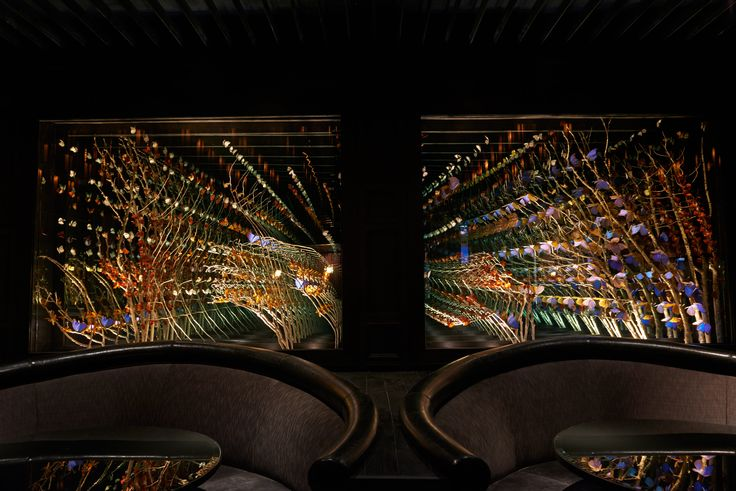 Installation created using 3,000 real butterflies and moths, real tree branches, and infinity mirror boxes for Chi Lin restaurant in West Hollywood, California. #installationart #butterflies #infinitymirrors