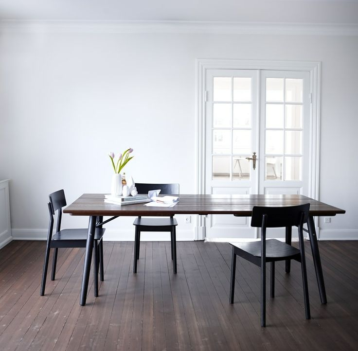 The warm oil treated smoked oak Split table surrounded by the black Pause dining chairs  • Designed by @sayswhodesign #diningtable #table #planktable #design #WOUDdesign