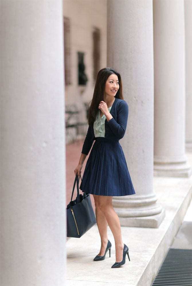navy pleated skirt + cropped cardigan // spring office outfit ideas for work