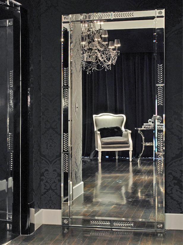 The black wallpaper, silver accents, and crystal chandelier add such drama to this gorgeous boudoir. Adore this design.