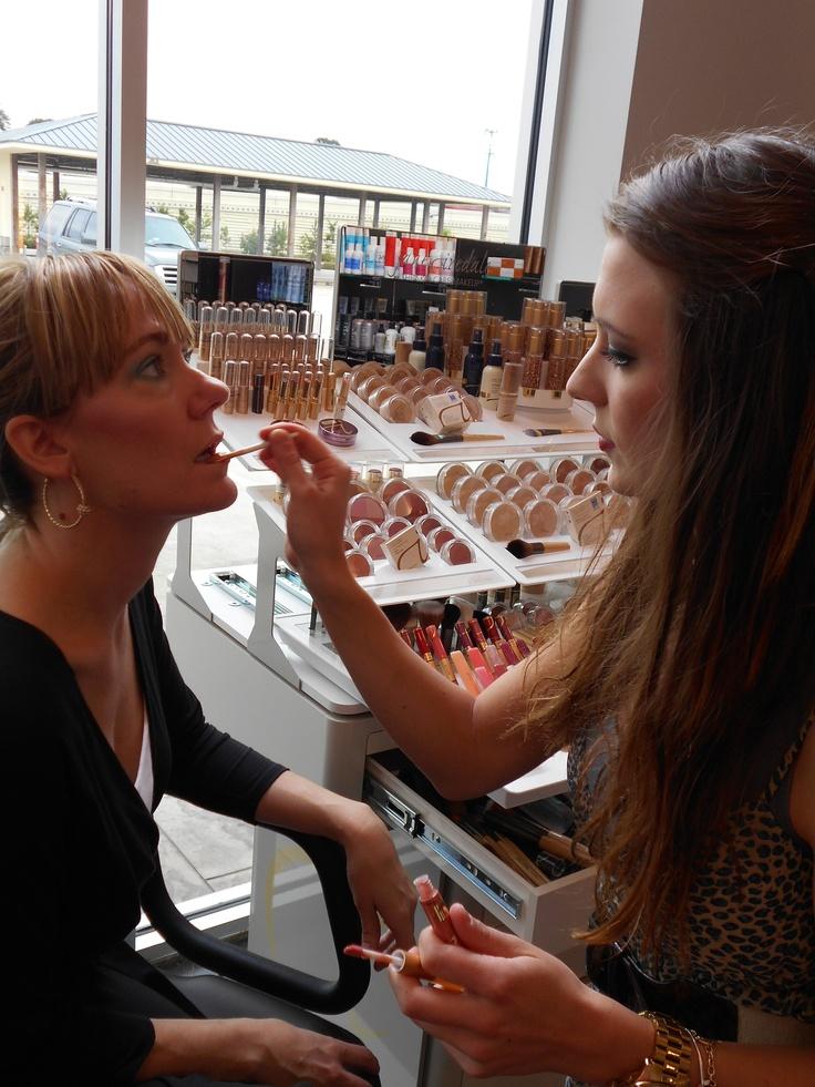 Makeup Artist, Brittany Gala applying our firstclass