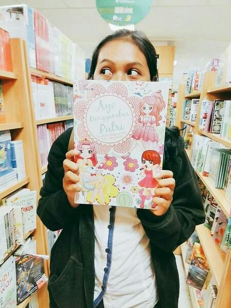 I feel cute in this photo ☺😊 by the way i really love book.
