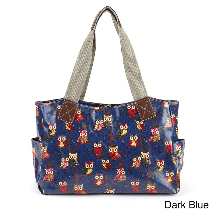 Made of durable coated canvas (called oilcloth,) this roomy bag sports a vibrant owl print across the exterior. Two open pockets on each side offer convenient access to your keys, phone, or even a water bottle.