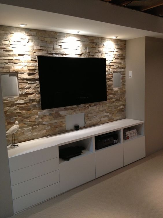 Stone wall with entertainment center Basement stone entertainment center  with ikea cupboards www.