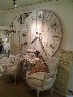 diy large clock from pallet wood. You can buy high torque (for long hands) clock works and extra long hands at Klockit on line. If you want large numbers, you can use house numbers.
