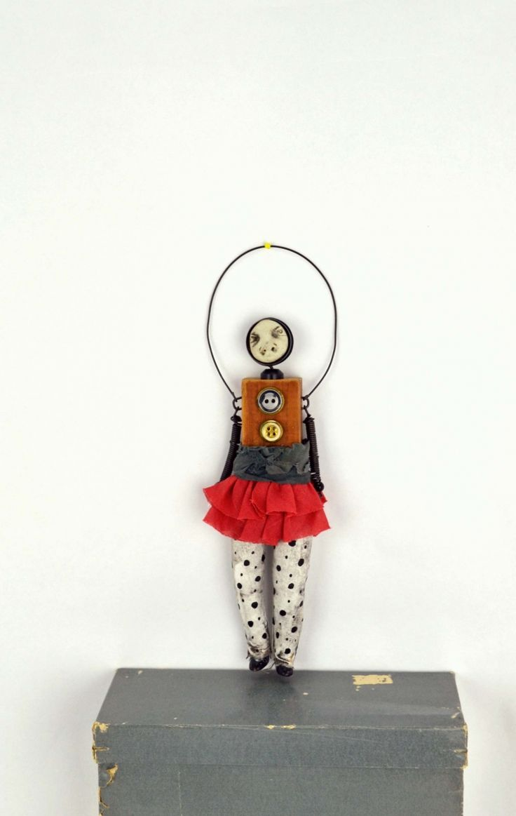"""Mixed media art doll Tipper.She is back from an extended stay at Tito's Gallery located in Las Vegas, New Mexico. She measures10.5""""x2.5'x1"""". Her legs are cotton fabric stuffed with polyfil and then painted. Her arms are made from wire and feet are porcelain."""