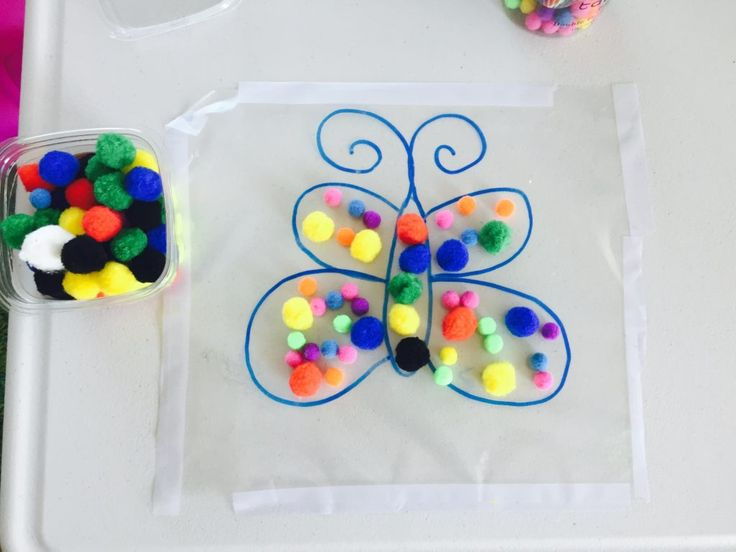 Decorate butterfly with pompoms, activities for 1.5 year old, activities for two year old, activities for toddlers, toddler crafts, creative activities for toddlers, activities for 18 month old, activities for 19 month old, activities for 20 month old, activities for 21 month old, activities for 22 month old, activities for 23 month old, activities for 24 month old