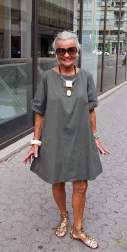 Grey tunic dress + statement necklace + chunky bracelet + gold gladiator sandals :: That's Not My Age