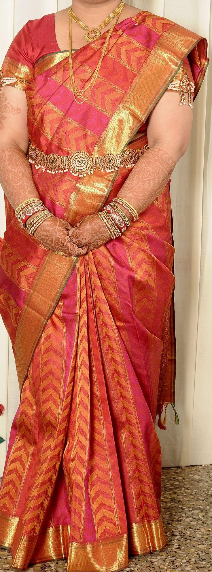 Red and pink Kanchipuram bridal silk saree.