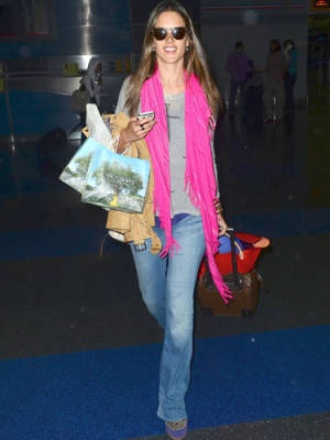 Alessandro Ambrosio rocks a neon scarf at the airport