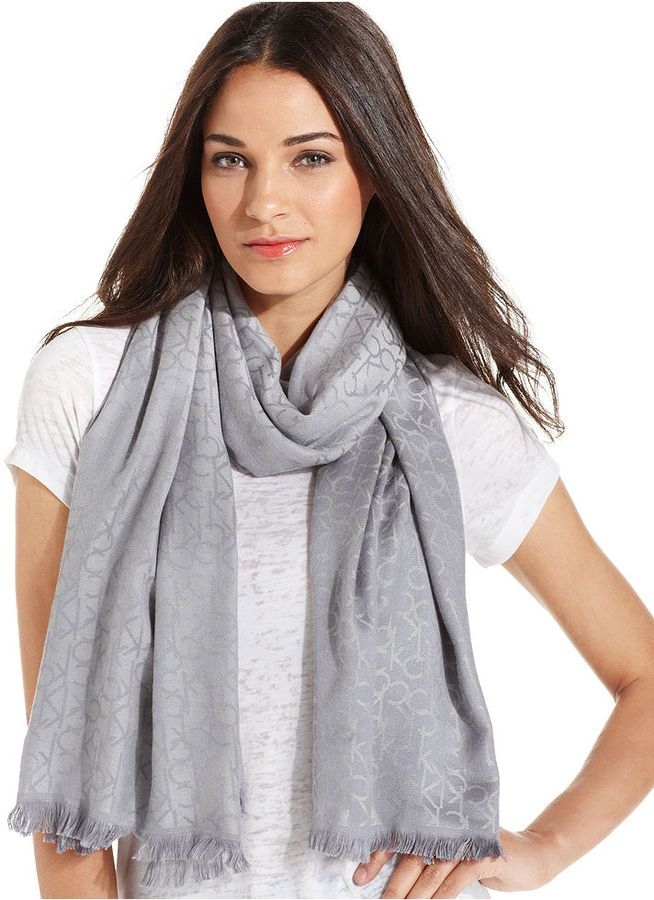 $38, Grey Scarf: Calvin Klein Ck Logo Pashmina Wrap. Sold by Macy's. Click for more info: https://lookastic.com/women/shop_items/52126/redirect