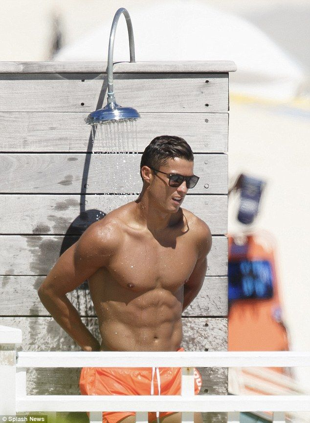 Cooling off: The sports ace took a cold shower to wash the salt water from his rippling to...