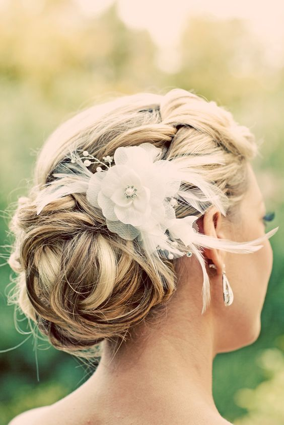 edding hairstyle with hair decoration / http://www.himisspuff.com/beautiful-wedding-updo-hairstyles/3/