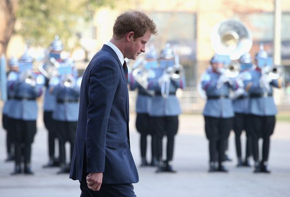 Prince Harry lays a wreath at the monument to the founding Father of Chile Bernando O'Higgins on June 27, 2014 in Santiago, Chile.