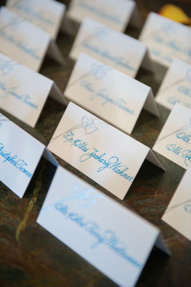 Aqua calligraphy escort cards (Photo by Jeff Kolodny Photography)