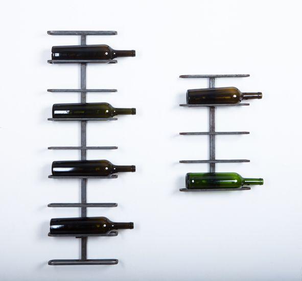 Полка для 9ти и 5ти бутылок (Riesling)  Вертикальная настенная полка предназначена для хранения вина в горизонтальном положении. На задней части стоки имеются крепежи для стен. Вы можете выбрать полку на 9 бутылок или на 5 бутылок. Общие размеры держателя для бутылок вина (Riesling) на 9 бутолок: 93,3х27.5х9.5 см Возможные цветовые решения : черный, слоновая кость, ржавый металл + лак. Артикул: М-014 Цена полки на 9 бутылок 7200 руб. на 5 бутылок 3800 руб.