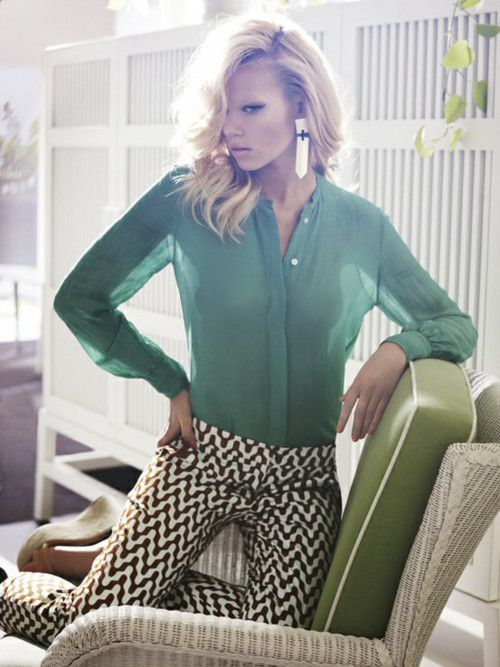 Patterned trousers and the mint green blouse look great together