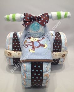 Little Monkey Tricycle Diaper Cake for Boy http://babyfavorsandgifts.com/little-monkey-tricycle-diaper-cake-for-boy-p-331.html