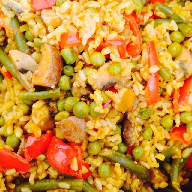 Deliciously Ella, Book 2, Page 174: Veggie Paella. Made with fresh coriander, coconut milk, brown rice, saffron threads, cherry tomatoes, garlic cloves, olive oil, lemon juice, paprika, cayenne pepper, green beans, frozen peas, red peppers and chestnut mushrooms. Very nice meal, delicious hot or cold…