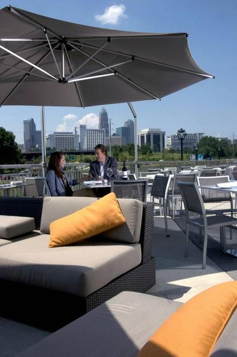 Diners enjoy a view of the charlotte skyline from the for Terrace restaurant charlotte