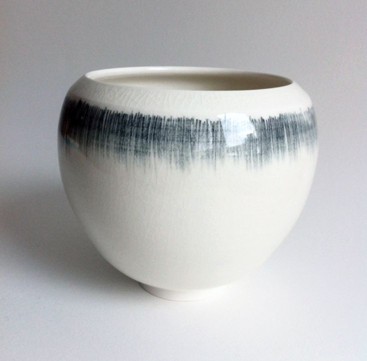 "Tom Kemp - drawn with an underglaze pencil then glazed with a clear gloss glaze, ""The glaze sometimes crackles if it's thicker, which I sometimes like."""