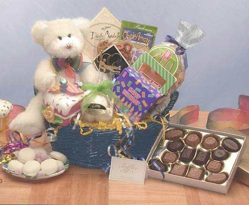 """This little bear in a gift basket comes to say """"Have a Beary Happy Birthday!"""" He brings candy, chocolates, cookies and other birthday treats as well as a cake-slice candle to light on your special day! Send someone you love the Have a Beary Happy Birthday gift basket for their special day!"""