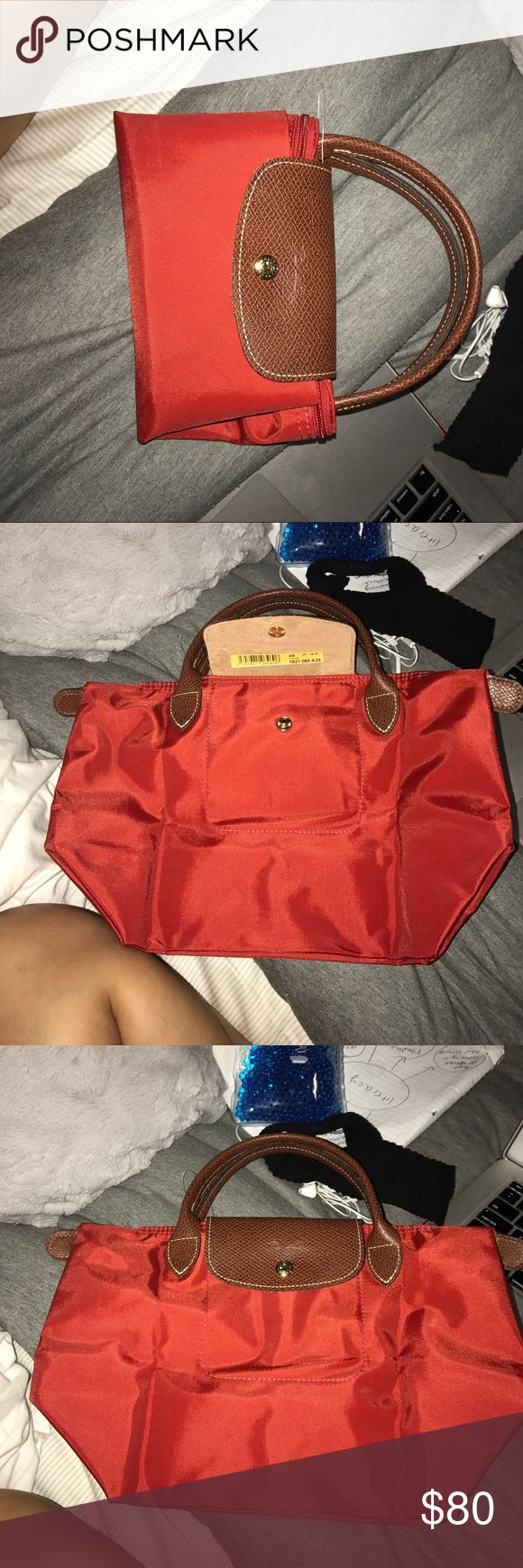 Long champ bag Red longchamp bag 95$ 105$ with tax unused, am will to change price if asked Longchamp Bags