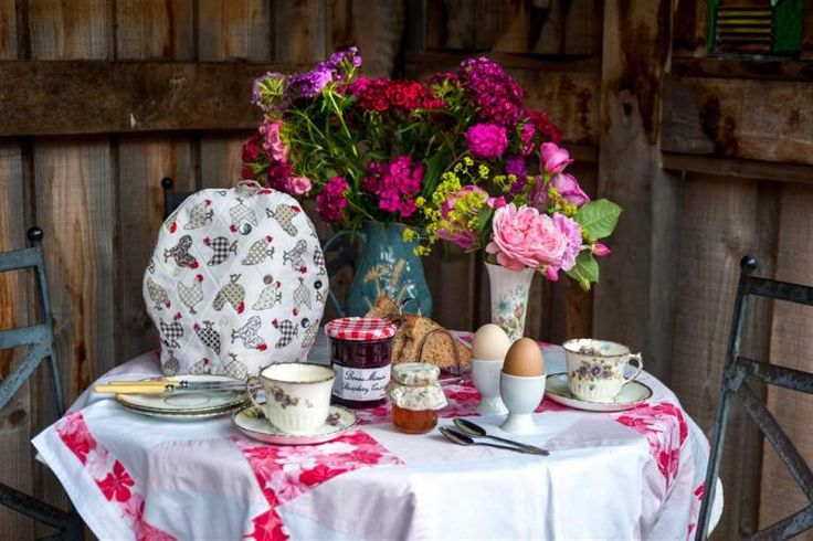 Breakfast anyone? cute corner of the garden at Nuthatch Cottage, watching the birds in the NGS rose garden, like something out of country living magazine! photo shoot for Brecon beacons holiday cottages, in wales