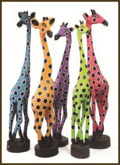 Gorgeous colourful wooden giraffes #africa #art #animals