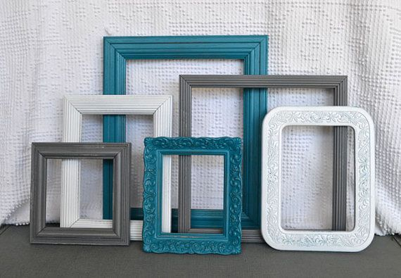 Teal, gray, and white painted frames. Artwork for the bedroom?
