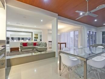 Modern dining room idea with floorboards & louvre windows - Dining Room Photo 1083977