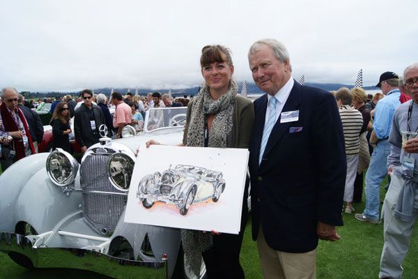 Anna-Louise Felstead photographed with Dr.Wolfgang Porsche having just been commissioned to paint his Austro Daimler at Pebble Beach in 2010