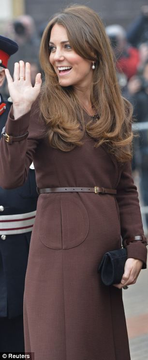 Pregnant: With her baby bump visible beneath her chocolate-coloured Hobbs coat, the Duchess arrived 90 minutes late for her visit to Grimsby's National Fishing Heritage Centre