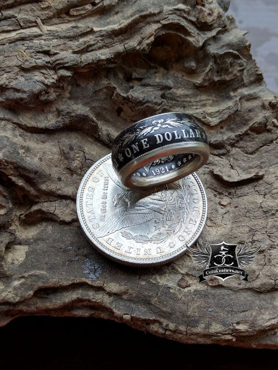 This coin ring features a real Morgan Silver Dollar expertly crafted and customized to your personality. With your choice of finishes, either in a beautiful polished silver, striking black patina, or a 1-sided band (Wedding Band Style), this silver dollar ring is sure to make a