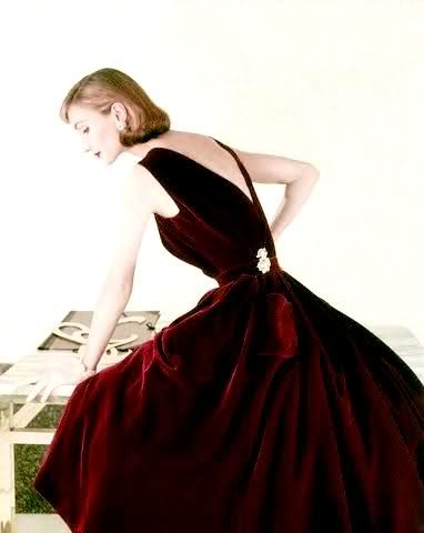 Evelyn Tripp in a v-backed, garnet velvet dress by Digby Morton, 1955