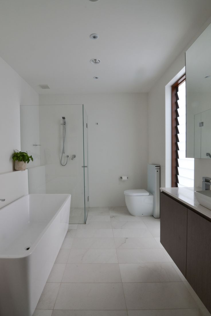 White Bathroom for the Children in the Courtyard House with Custom Timber Veneer Vanity