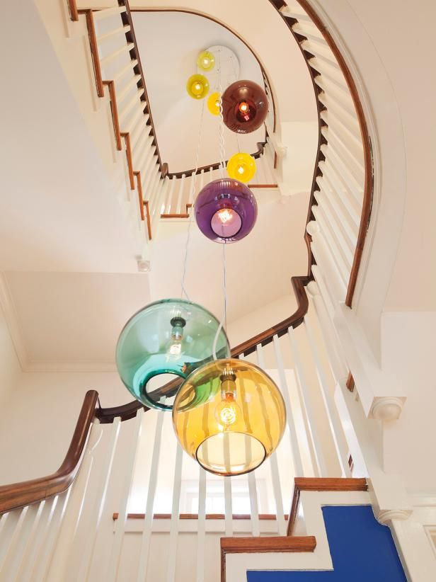 HGTV: Check out the colorful tiered chandelier illuminating this traditional stairway.