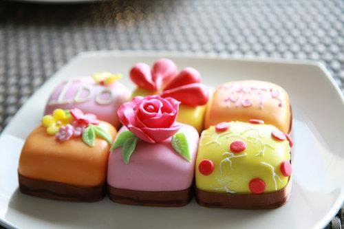 These sweet petit fours are so whimsical and chic. They look like a delicious two-bite dessert.