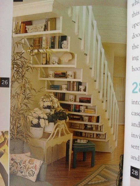 white wood staircase with reverse under shelves