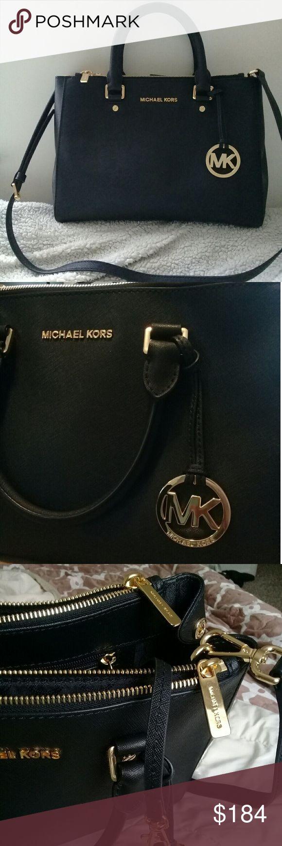 New Michael Kors Black Leather Purse nwot, leather, expandable, plenty of storage compartments, shoulder strap. MICHAEL Michael Kors Bags