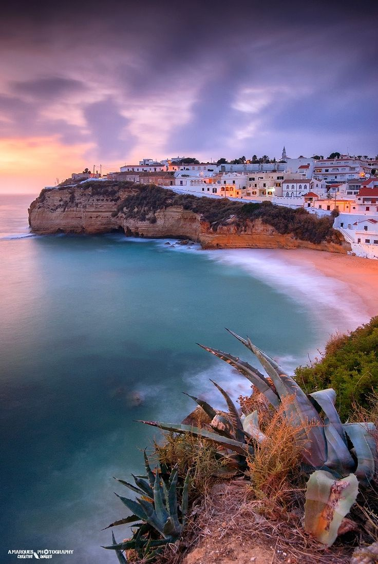 By the sea - Beautiful view on the beach at sunset in Carvoeiro, Algarve, Portugal.