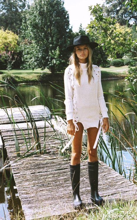rain boots and black hat