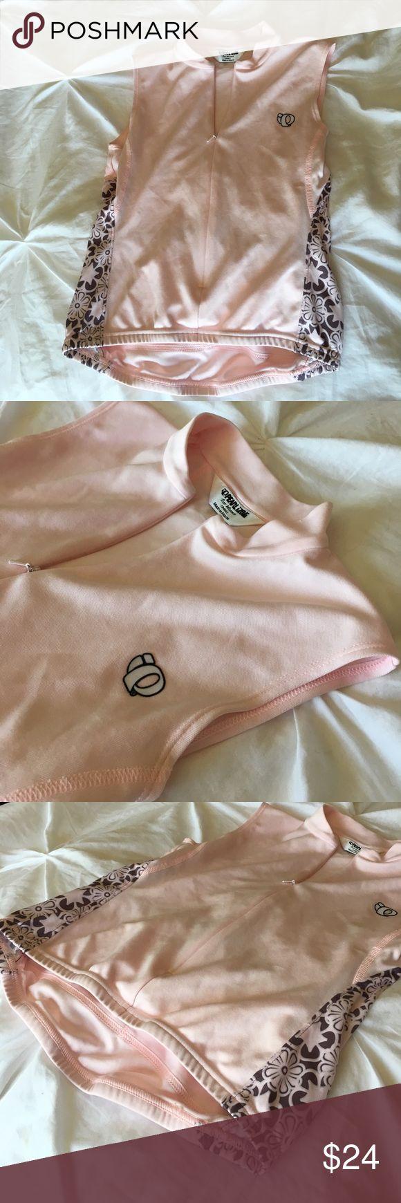PearlIzumi sz S pink cycling top. Two back pockets Pearl Izumi, size Small pink sleeveless cycling top. Two back pockets. Elastic waist to keep in place. Smoke free home. Pearl Izumi Tops